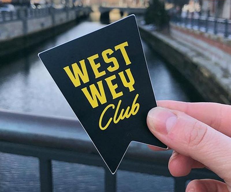 Hand holding west way club card